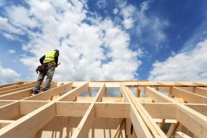 A roofing contractor examining a new home