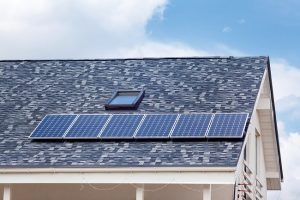 Large blue tile roof with solar panel
