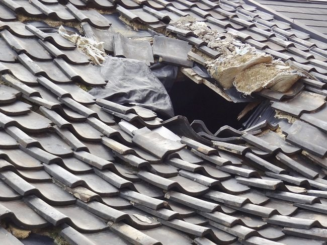 Hole in a roof with other debris around it