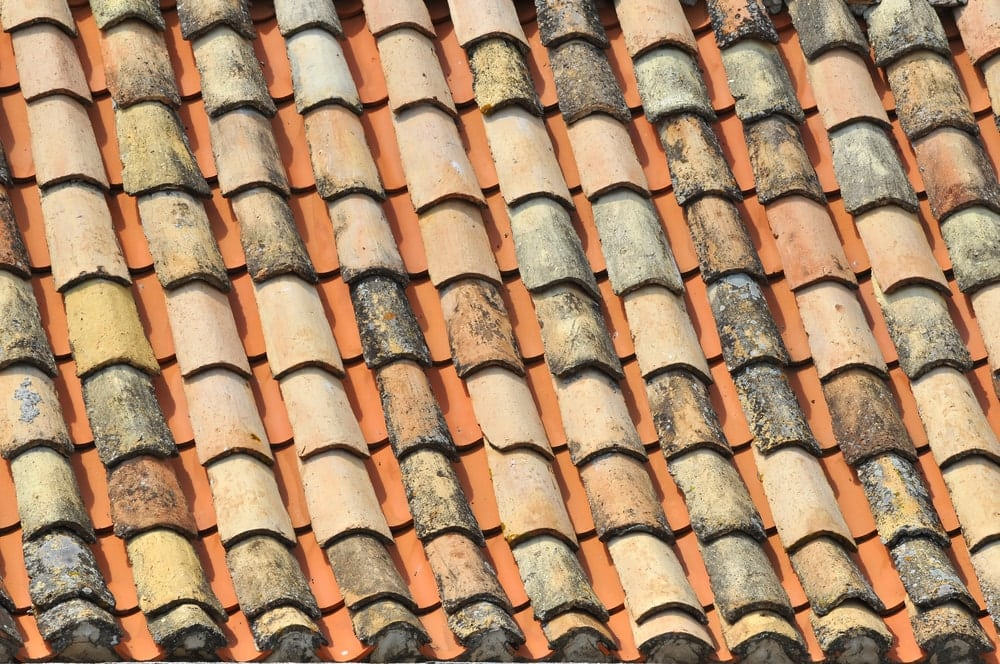 rows of roman roof tiles on a house in the Mediterranean area